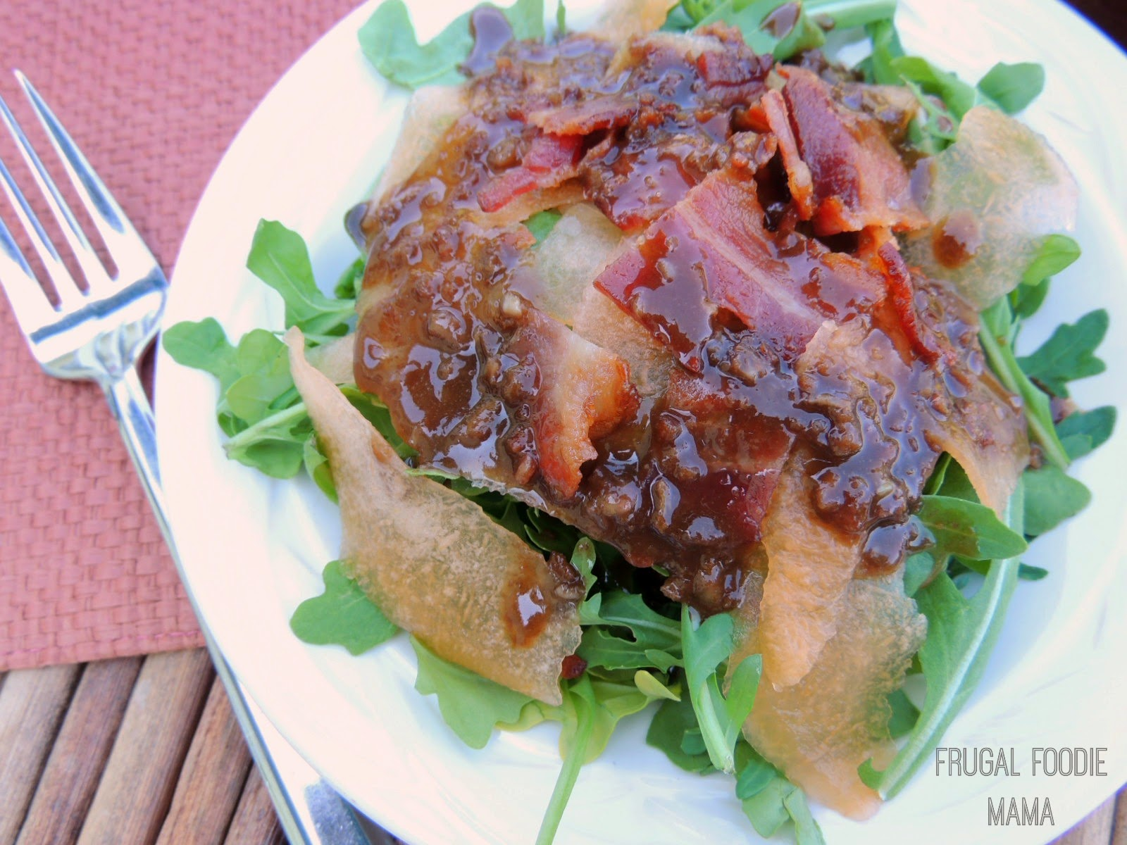 Bacon, Cantaloupe, and Arugula Salad with Bacon Balsamic Dressing via thefrugalfoodiemama.com