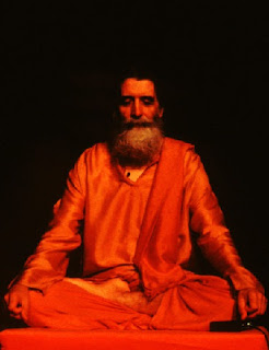 Image of and Indian yogi, meditating, saffron dress