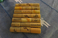 4 by 6 inch trivet made of 7 rows of plastic wine corks, 3 corks per row