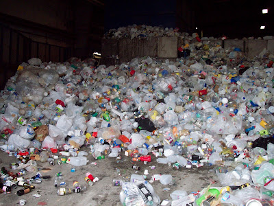 Pile of glass and metal products in a warehouse setting