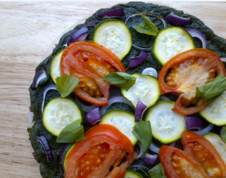 basil & almond pesto, red onion, courgette and plum tomato topped pizza on ella's quinoa crust (vegan & gf)