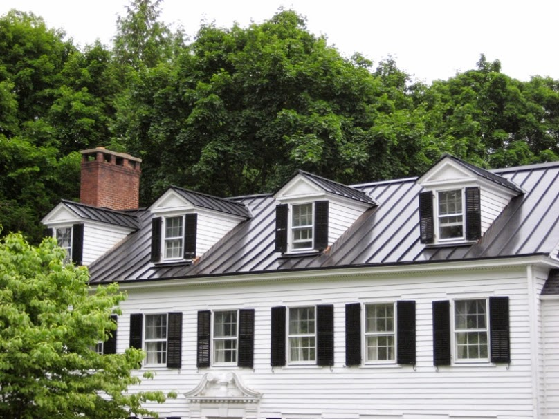 Metal rofing choosing the best metal roof for your house for Homes with metal roofs photos