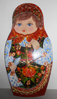 "Wall clock in the form of matryoshka (nesting dolls) handmade with painting in russian folk styles khokhloma and volkhovskaya. Size: 11.8"" x 6"" (30 cm x 15 cm)"