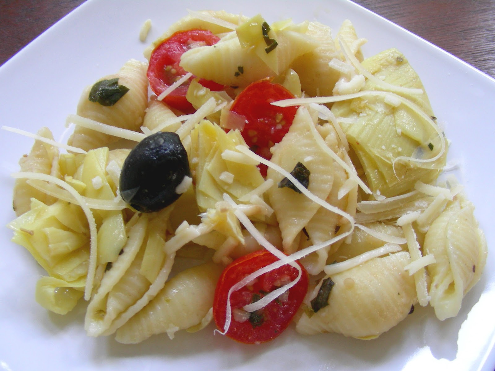 shells with artichokes, tomatoes + olives
