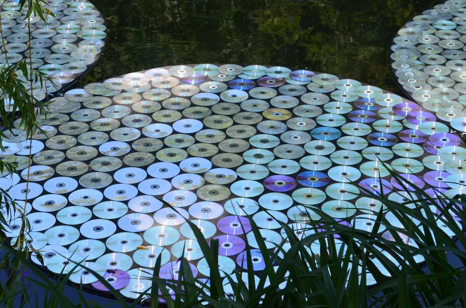 Поделки из дисков своими руками для дачи фото