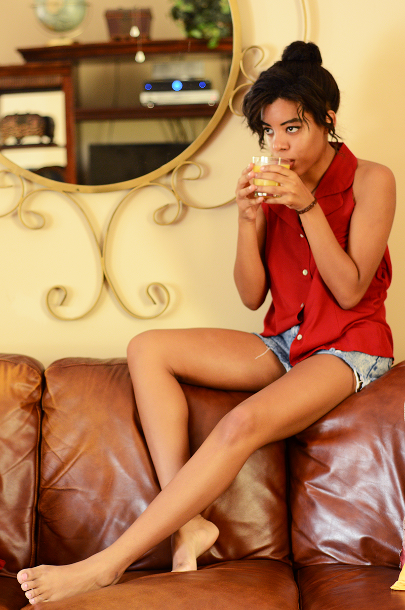 Miami Fashion and Indie Culture Blogger Anais Alexandre wearing a vintage red top and destroyed jean shorts