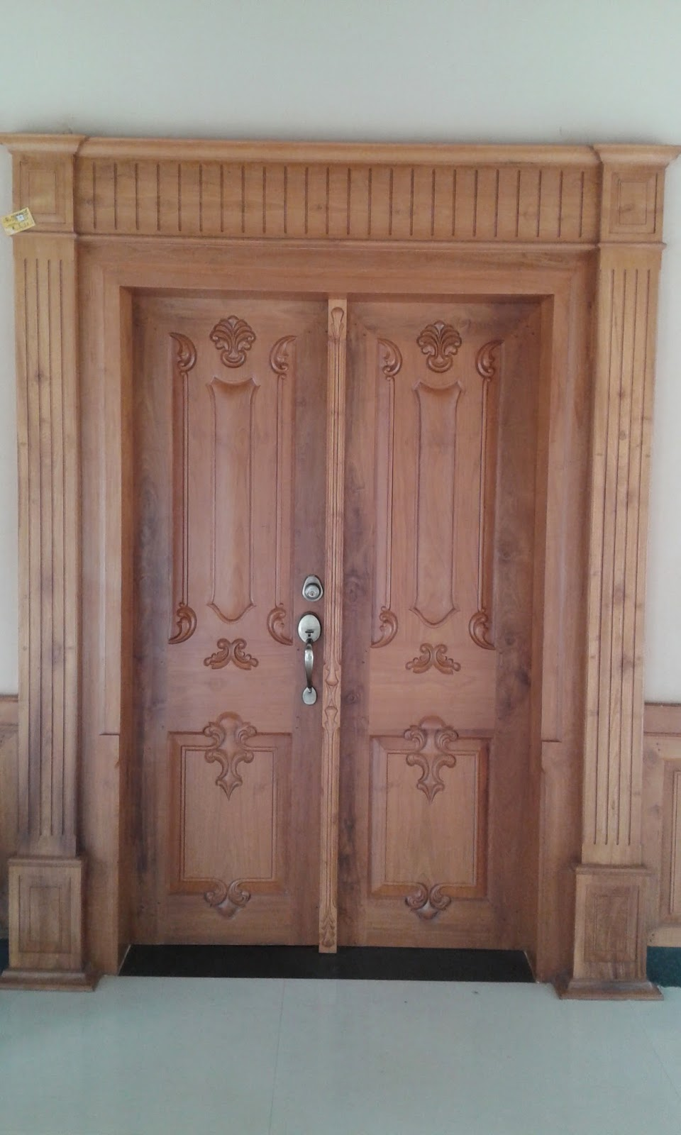 Kerala style carpenter works and designs main entrance for Front double door designs indian houses