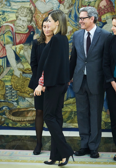 Queen Letizia  attends an audience with a Representation of Gypsy Secretariat Foundation at Zarzuela Palace. Queen Letizia wore ZARA Cape Jacket - HUGO BOSS Taru Trousers - Magrit pumps Tous Jewelery