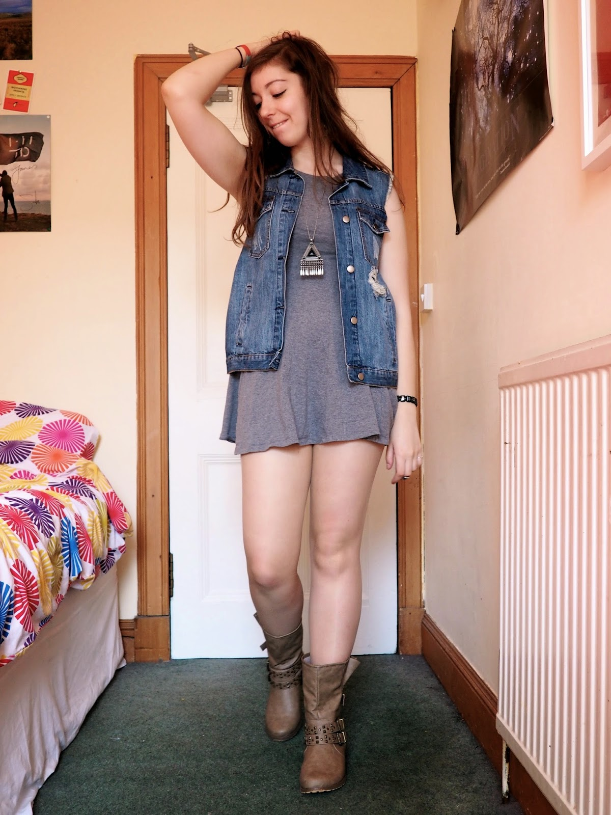 Distressed Denim outfit | ripped denim vest, short grey dress, brown studded boots
