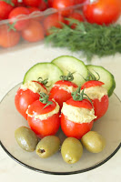 http://theseamanmom.com/stuffed-tomatoes-with-eggplant/