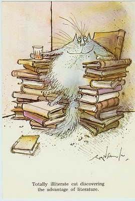 Totally illiterate cat discovering the advantage of literature (Ronald Searle)