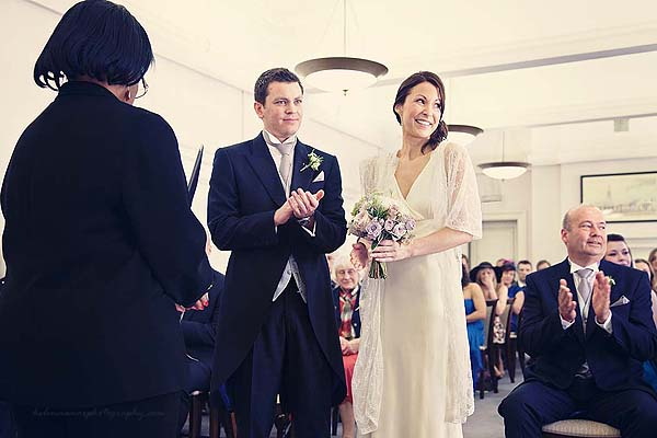 bride and groom during ceremony speech at Marylebone Town Hall wedding