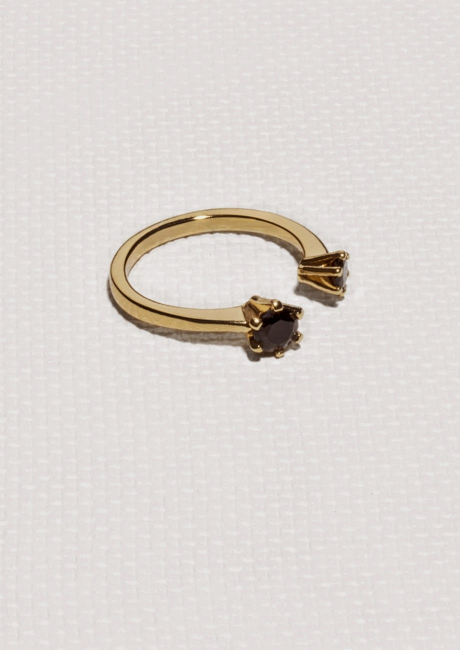 gold double ring with black stone