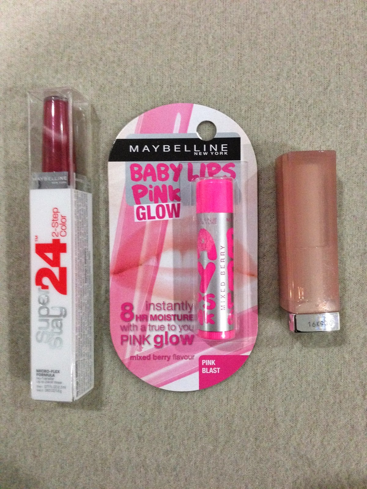 Maybelline The Baby Lips Pink Glow Lipbalm in shade Pink Blast; the Super Stay 24hr 2-Step Color in shade All Day Cherry and a Color Sensational lipstick from the Stripped Nudes Collection in shade 740 Coffee Craze.