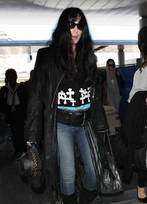 Cher, in jeans, walking through LAX Airport