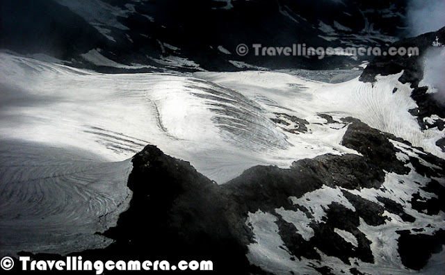 Shrikhand Mahadev in Himachal Pradesh is one of the most difficult Treks, I have done so far. All these photographs are more than 4 years old now, but memories are still fresh in our mind. This Photo Journey is sharing some of the black & White photographs shot during Shrikhand Mahadev Trek in 2008. Let's check out and know more about this wonderful place in Himalayas...Very first photograph shows a huge rock standing still on top of snow covered hill at the height of approximately 1700 feets. This place is of high importance for Shiva followers. This rock is considered as Shivling and every year various pilgrim come to this place from various parts of the country. This Trek opens in July for approximately 3 months. I remember the moment when this Trek was planned by Vikas, Vishal & Narender Ji... I was one of the passive member who was not involved in planning and other folks were best at it :) ... It was very quick plan... Three of us started from Delhi and all of us met at Shimla to start next journey. We went till Nirmand Town in our car and parked it there at some friend's home... From their, we hired a cab to drop us at Jaon Village. jaon village is base from where Shrikhand Mahadev Trek Starts. This whole stretch from Jaon to Shrikhand Mahadev peak was very beautiful with various herbs, plants and flowers on the way...This climb from Jaon to Shrikhand peak took 3 days and third day was mainly through rocky hills with not plants and most of them covered with snow... Last day was challenging one with last stretch was also creating some breathing problems for some of us.. So idea was to reach final destination, spend little time there and come back to Parvali Bag for spending night... During back journey we took 2 days to reach Jaon Village...Here is another photographs from third day of climb.. This place is just above Nain-Sarovar... I call it cloud store... Even this kind of clouds can't be seen from airplane... The size of hills in background will give you s