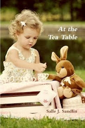 AT THE TEA TABLE