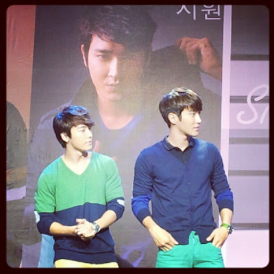 Siwon and Donghae in Trinoma with Siwon's Poster in the background