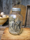 Old Jar filled with Grungy Prim Wax Eggs