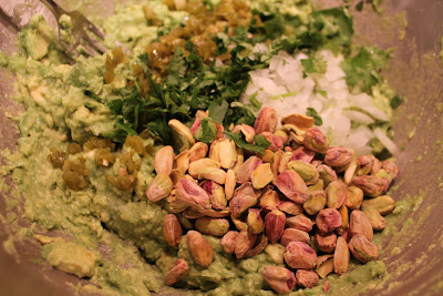 Pistachio, onion, pickled jalapeño and cilantro added to mashed avocado and lime