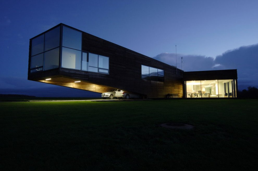 Contemporary cantilever house in lithuania most beautiful for Wood house architecture