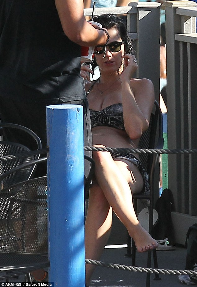 Katy Perry has a wardrobe malfunction and puts her bottom on display at water park