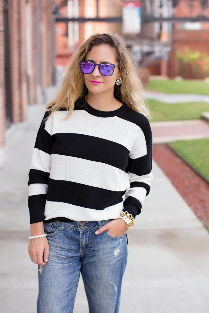 purple mirror sunglasses with stripe sweater