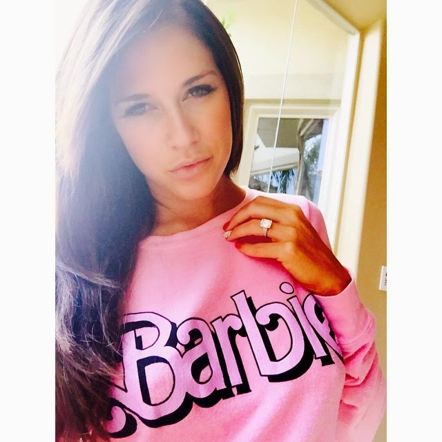 Kelly Kelly Shows Off Her Barbie Sweater.