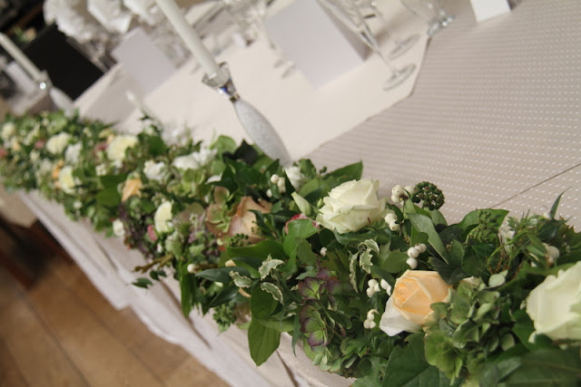 The top table garland of fresh Roses Hydrangeas Lissianthus Snow Berries