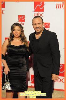 الفنان هشام عباس وزوجته