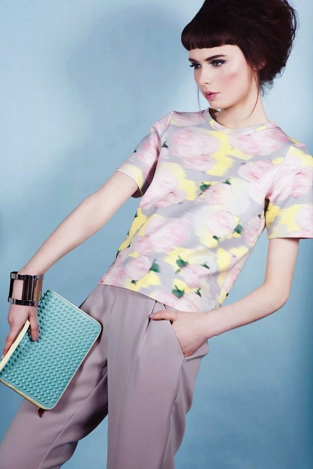 Bouffant sixties style hair and perfect contouring makeup compliment pastel tailored clothes