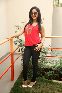 Swathi Deekshith in Spicy Red Tank Top Black Leggings at Ladies and Gentlemen Movie Success Meet
