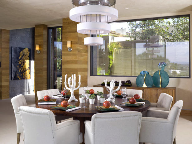 design tip the wow factor in this room is not just from the artwork and flowers but also the important contrast in dark white colors on the chairs - Colorful Modern Dining Room