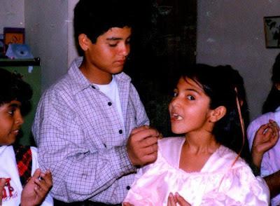 Anushka Childhood Photo eating cake