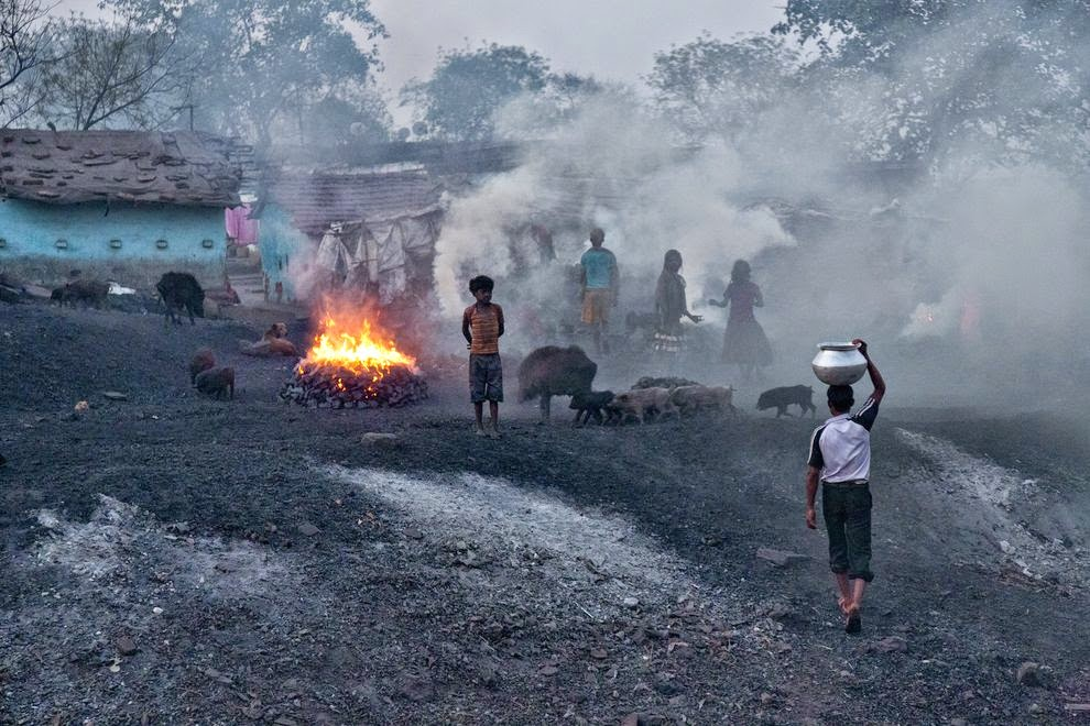 The air is thick with smoke from coal fires in this mining camp in Jharkhand, India. (Credit: Robb Kendrick, National Geographic) Click to Enlarge.