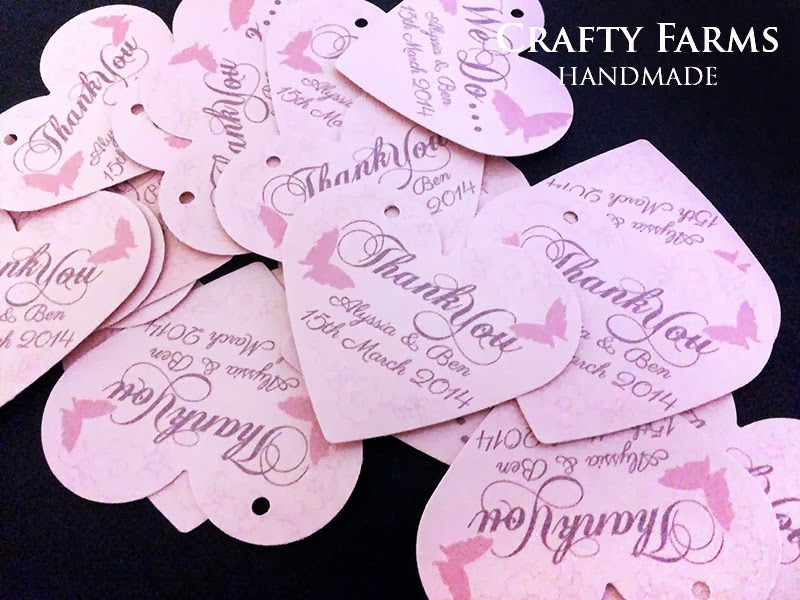 Heart shape wedding thank you tag and stationery in pinkish peach and purple butterflies