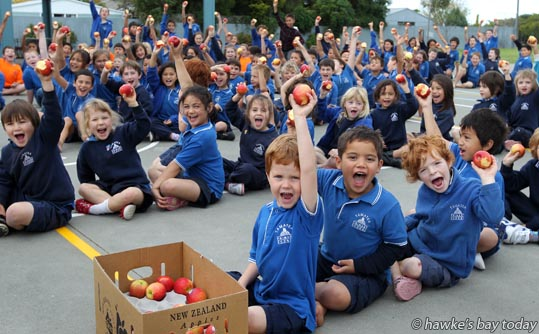 Front L-R: Jamin Weston, Michael Northcroft, Gemma Dean - names correct - about 160 children at Tamatea Primary School, Tamatea, Napier, joined about 15,000 pupils from around New Zealand in a Jazz Apple Big Crunch, biting into a jazz apple at 1413 on 10/05/13, counted down on Classic Hits FM. They beat the previous world record of 9,329 children photograph