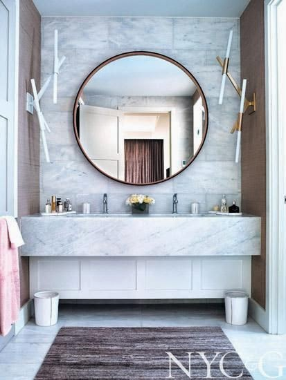 elegant modern powder room with white marble wall sink and round mirror