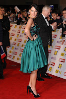 Tulisa Contostavlos posing in a green dress