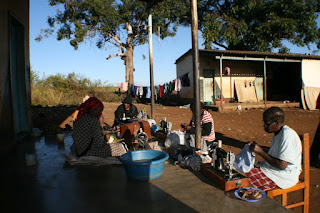 Some of the ladies sewing on the front porch in Vuvulane