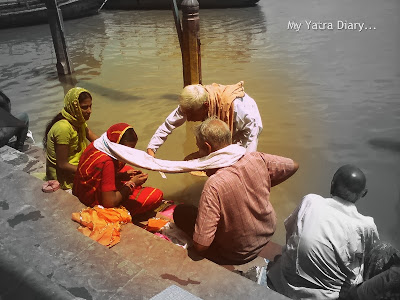 Believers doing shraddha at the Yamuna River Ghat, Mathura
