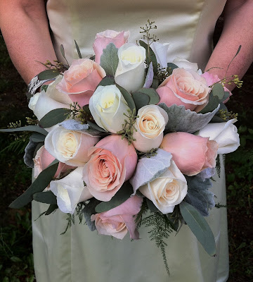 Bridal bouquet of creamy colored roses and soft dusty miller by Stein Your Florist Co. in Philadelphia, PA