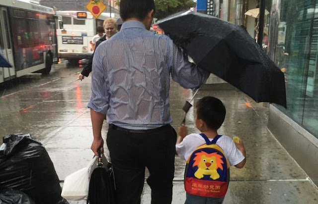 The internet loves 'umbrella dad' and his act of selfless devotion