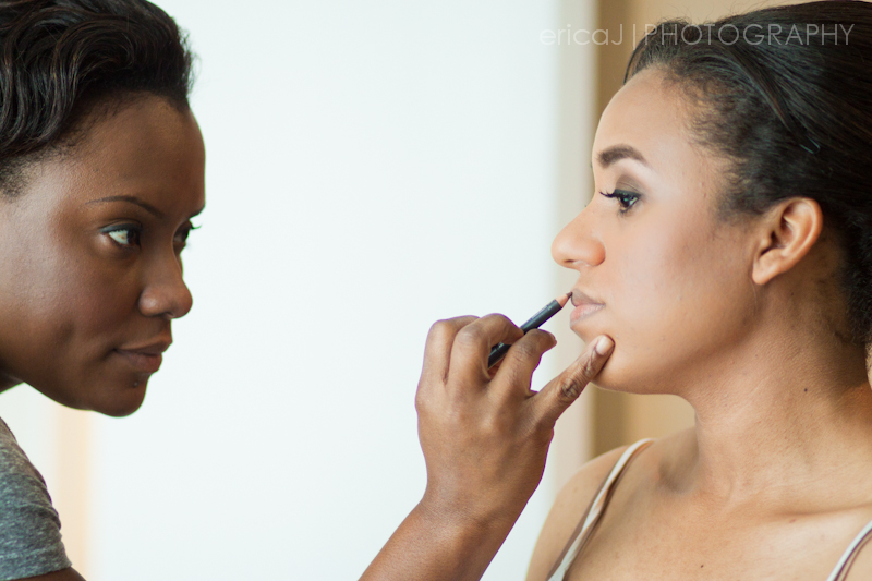 Yaneth Gray makeup artist applying makeup to bride