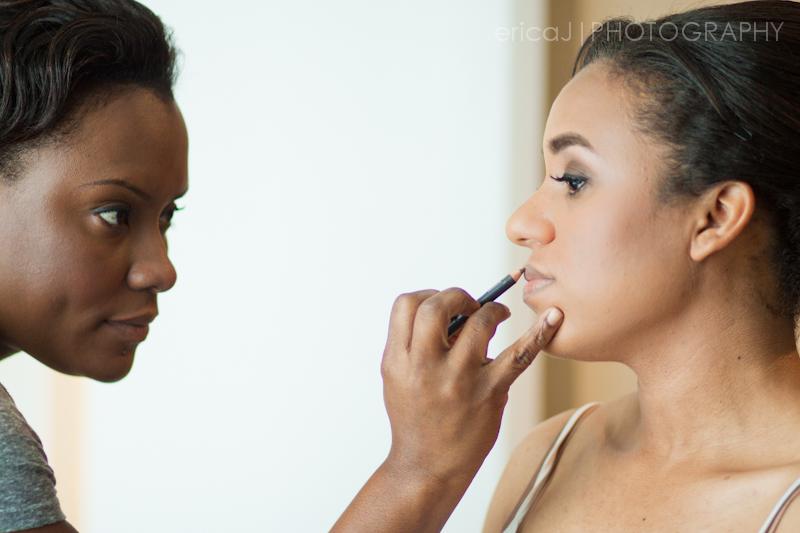 Yaneth Gray makeup artist applying makeup to bride
