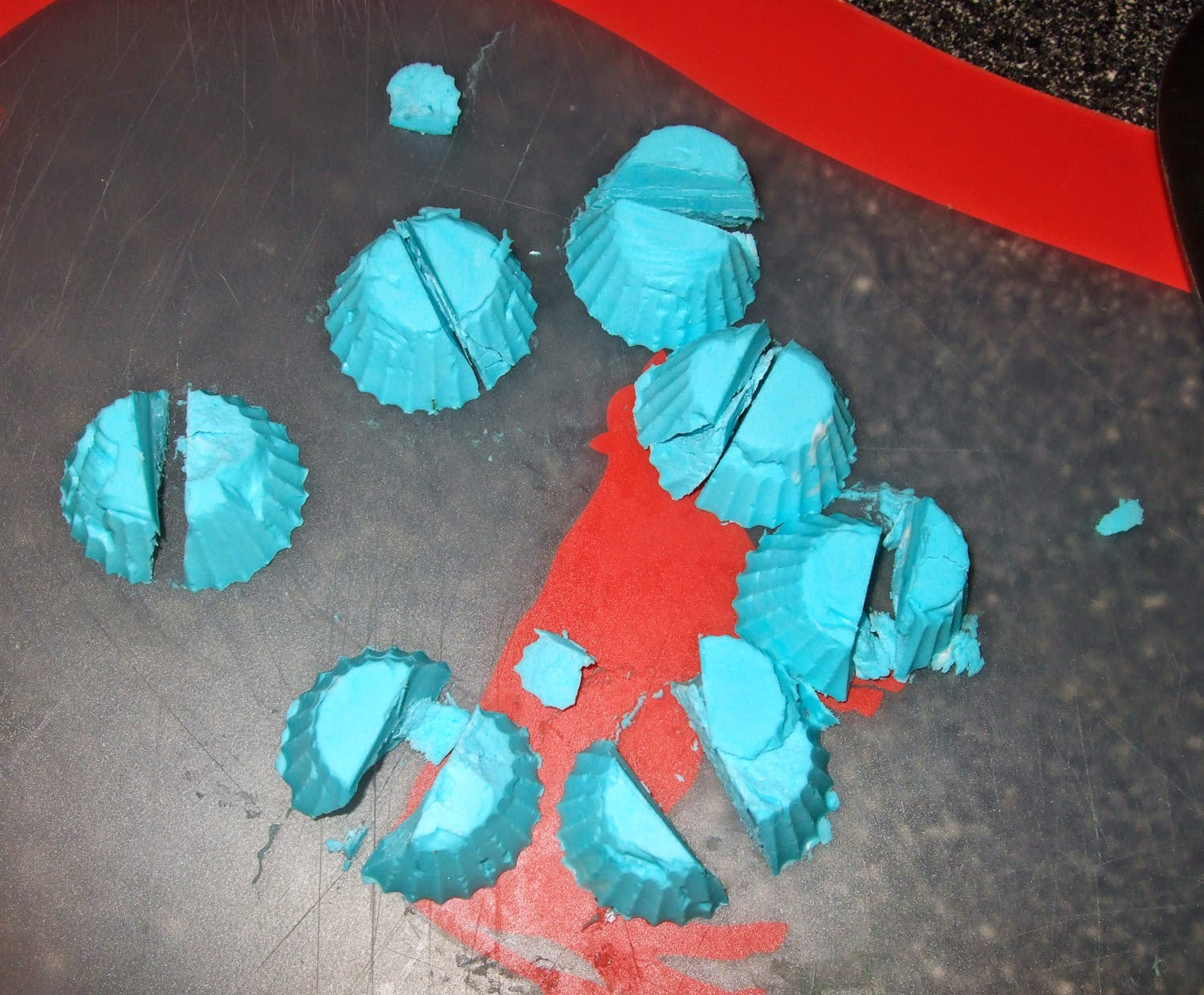 Cut up blue frosting bombs.