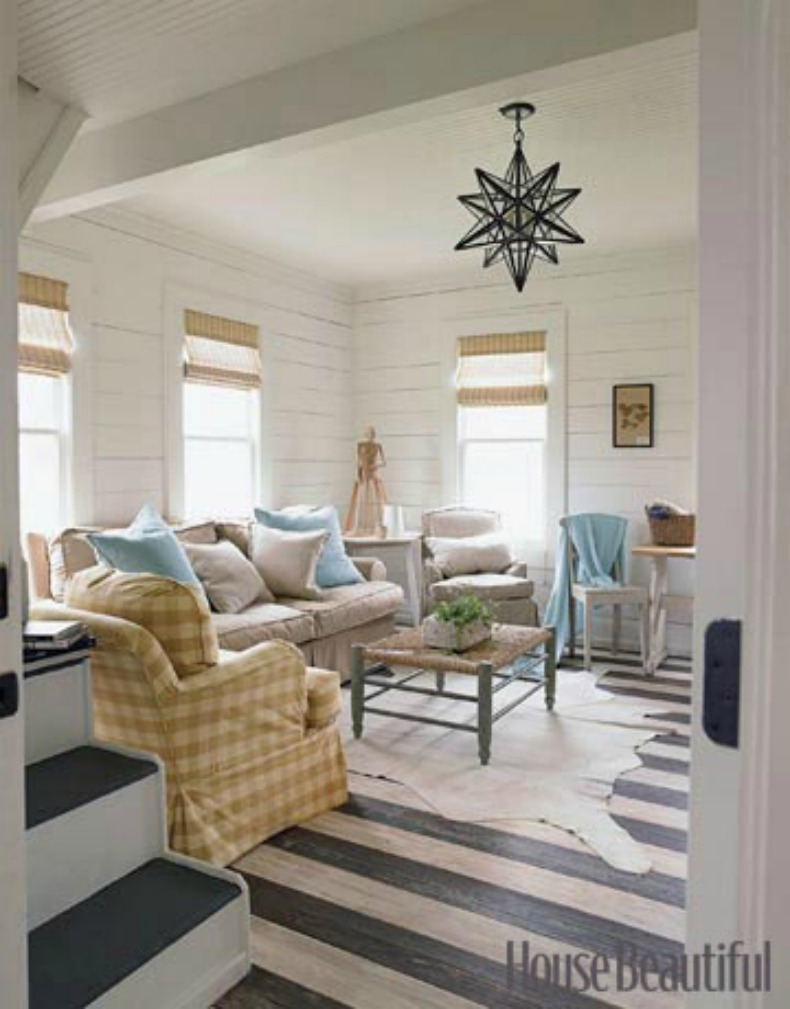 Coastal cottage living room with slipcover sofas and chairs
