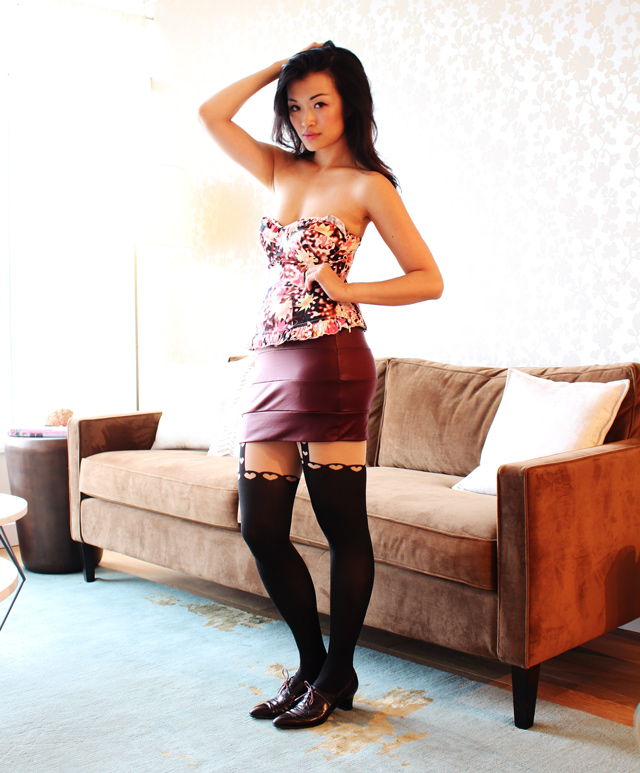 Layering for fall, vancouver fashion blogger jasmine zhu posing in vintage wearing floral corset, garter tights, wine color mini skirt, vintage oxford