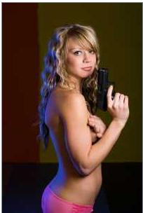 Blonde girl with a gun