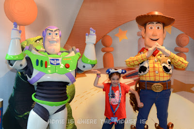 """Bella spells out """"U.S.A."""" with help from Buzz and Woody"""